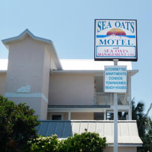 Frontal view of Sea Oats Motel and sign