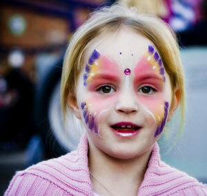 Child's face painted in sandestin for Halloween